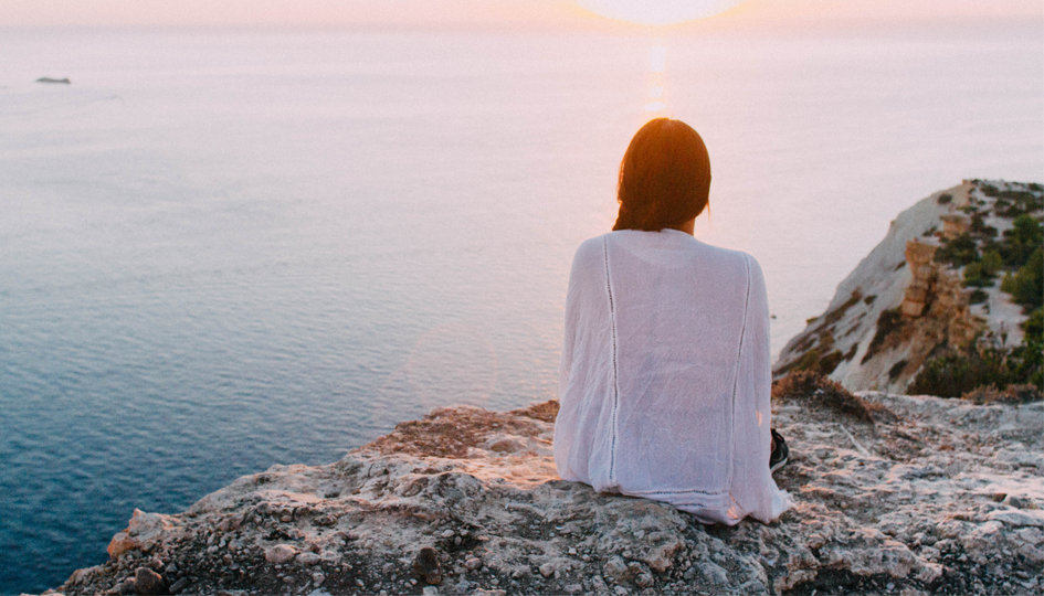 Woman overlooking the sea | Managing Mental Health | Benefits by Design