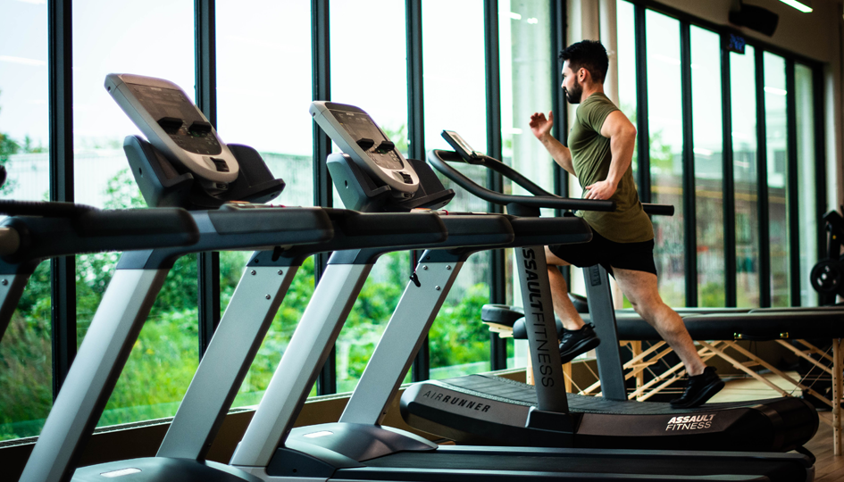 Man Running on Treadmill | Personal Spending Account | Benefits by Design