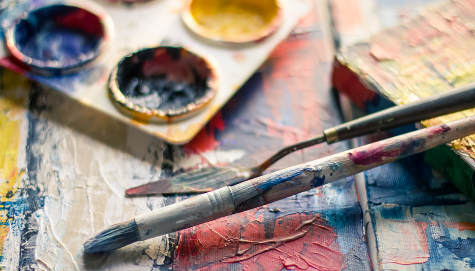 Paint brushes overtop of a painting   PSA   Benefits by Design