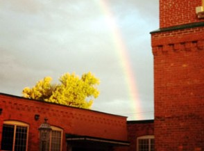 Woolen Mill in Kingston with rainbow over it