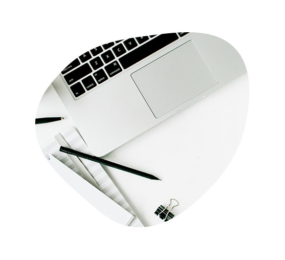 Laptop with a pen resting on the trackpad