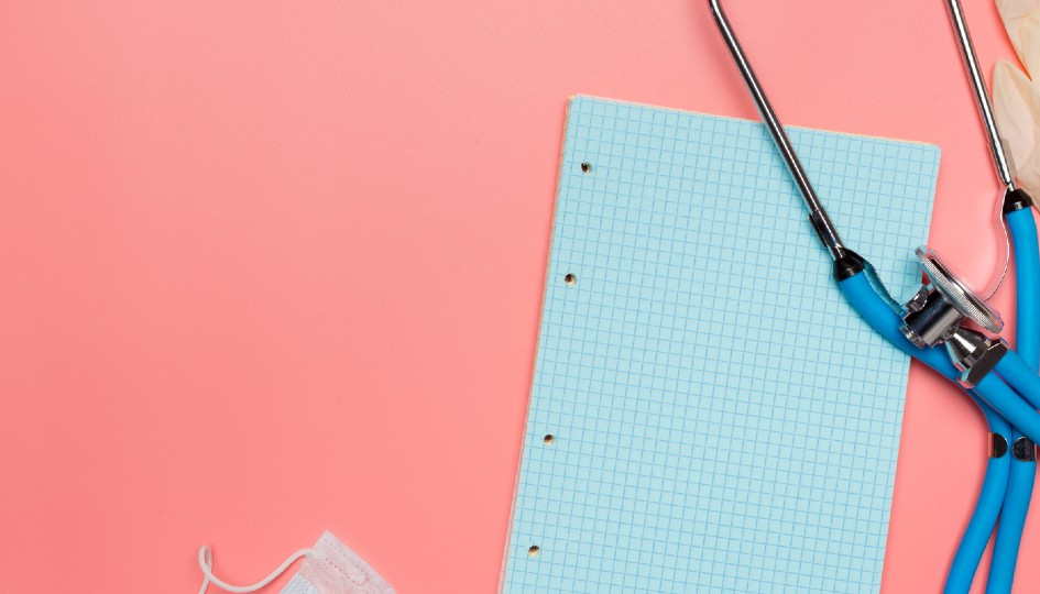 Piece of paper on a pink background